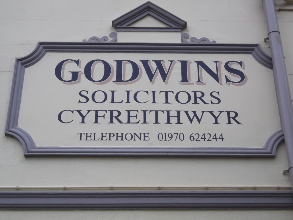 Aberystwyth Signs for Godwins Solicitors